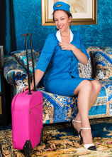 Anilos - Flight Attendant Featuring Claire Adams. (photos)